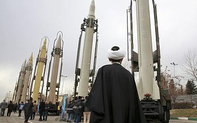 An Iranian clergyman looks at domestically built surface to surface missiles displayed by the Revolutionary Guard in a military show marking the 40th anniversary of the Islamic Revolution, at Imam Khomeini Grand Mosque in Tehran, Iran, February 3, 2019. (Vahid Salemi/AP)