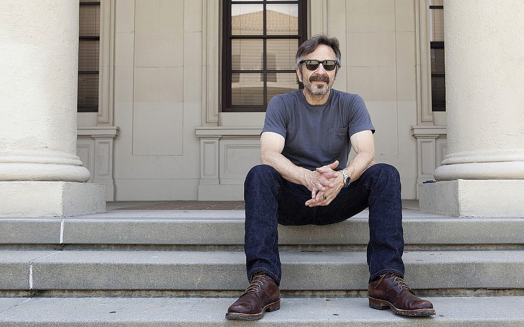 "This photo from June 11, 2019, shows actor, comedian and podcaster Marc Maron posing for a portrait in Los Angeles to promote his new indie comedy ""Sword of Trust."" (Photo by Rebecca Cabage/Invision/AP)"