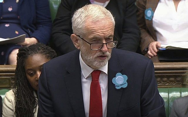 "Britain's main opposition Labour Party leader Jeremy Corbyn wears a ""Free Nazanin"" badge as he speaks during Prime Minister's Questions session at the House of Commons in London, June 26, 2019.  (House of Commons TV / PA via AP)"