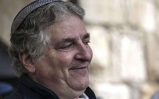American businessman Simon Falic attends the priestly blessing, during the Jewish holiday of Passover, at the Western Wall, in Jerusalem's Old City, April 22, 2019. (AP Photo/Tsafrir Abayov)