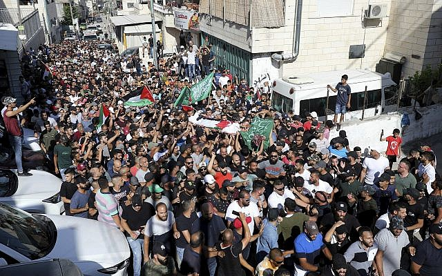 Illustrative: Palestinians carry the body of Mohammed Obeid during his funeral in the East Jerusalem neighborhood of Issawiya on July 1, 2019. (AP Photo/Mahmoud Ilean)