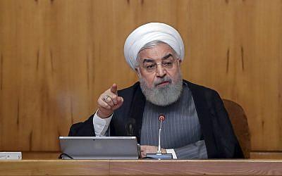 President Hassan Rouhani speaks in a cabinet meeting in Tehran, Iran, July 3, 2019. (Iranian Presidency Office via AP)