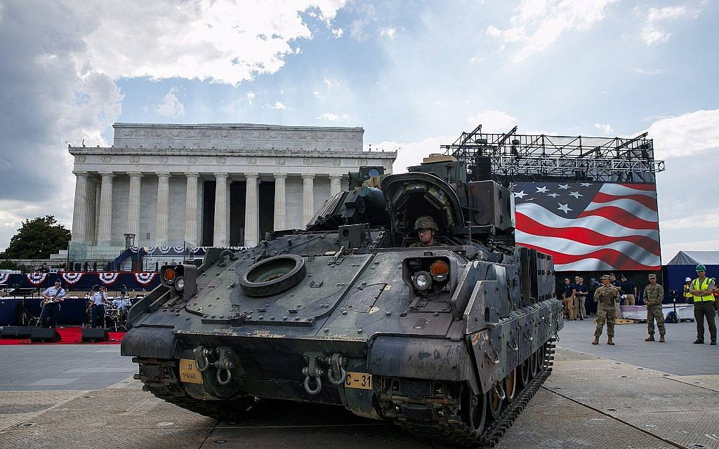 A US Army driver moves a Bradley Fighting Vehicle into place by the Lincoln Memorial in Washington, DC, ahead of planned Fourth of July festivities with President Donald Trump, on July 3, 2019. (AP Photo/Jacquelyn Martin)