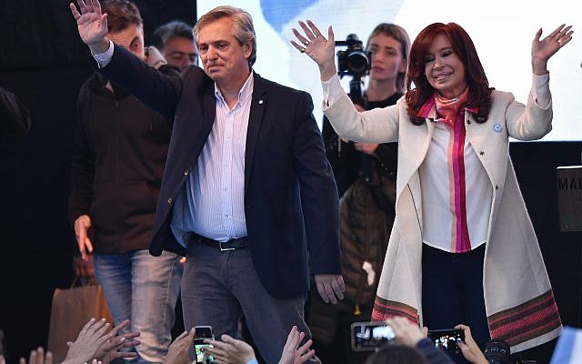 In this May 25, 2019 file photo, presidential candidate Alberto Fernandez, left, and his running-mate, former President Cristina Fernandez Kirchner, greet supporters during their kick-off campaign rally in Buenos Aires, Argentina. (AP Photo/Gustavo Garello, File)