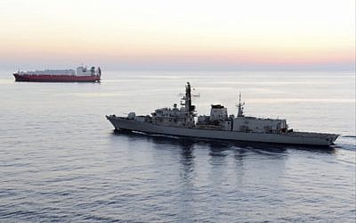 British navy vessel HMS Montrose escorts another ship during a mission at sea off coast of Cyprus in February 2014. (UK Ministry of Defence via AP)