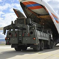 Military vehicles and equipment, parts of the S-400 air defense systems, are unloaded from a Russian transport aircraft, at Murted military airport in Ankara, Turkey, July 12, 2019. (Turkish Defence Ministry via AP, Pool)