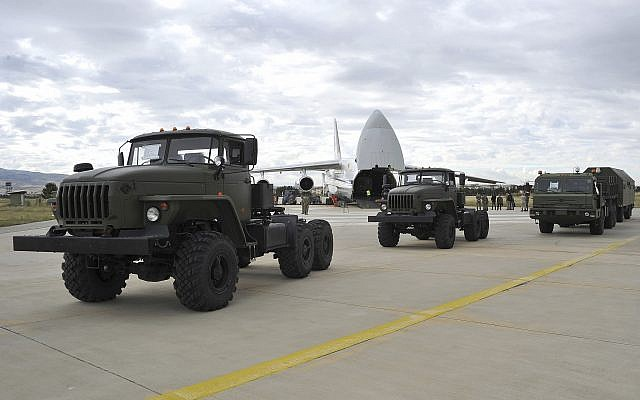 Military vehicles and equipment, parts of the S-400 defense systems, are seen on the tarmac, after they were unloaded from a Russian transport aircraft, at Murted military airport in Ankara, Turkey, Friday, July 12, 2019.  (Turkish Defence Ministry via AP, Pool)