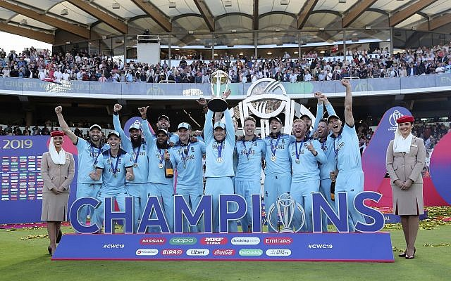 England's captain Eoin Morgan lifts the trophy after winning the Cricket World Cup final match between England and New Zealand at Lord's cricket ground in London, England, July 14, 2019. England won the Cricket World Cup for the first time in extraordinary circumstances, beating New Zealand by a tiebreaker of boundaries scored after the match was tied after regulation play and then the first Super Over in the tournament's history. (AP Photo/Aijaz Rahi)