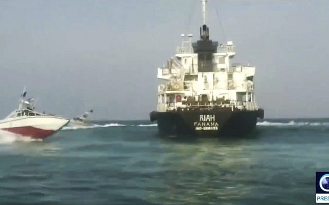 This undated photo provided by Iranian state television's English-language service, Press TV, on July 18, 2019, shows the Panamanian-flagged oil tanker MT Riah surrounded by Iranian Revolutionary Guard vessels. (Press TV via AP)