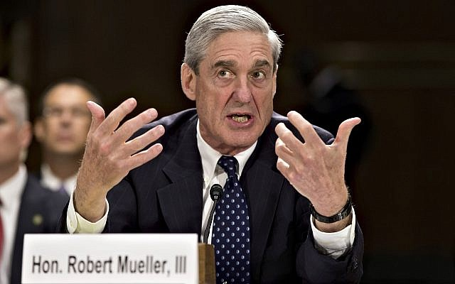In this file photo from June 19, 2013, then-FBI Director Robert Mueller testifies on Capitol Hill in Washington. (AP Photo/J. Scott Applewhite, file)