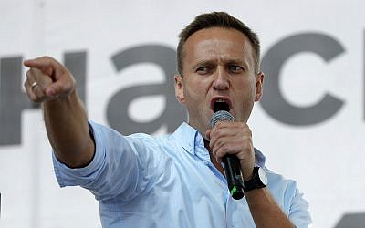 Russian opposition activist Alexei Navalny gestures while speaking to a crowd during a political protest in Moscow, Russia, Saturday, July 20, 2019. (AP Photo/Pavel Golovkin)
