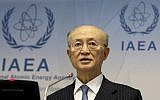 In this November 22, 2018, file photo, International Atomic Energy Agency (IAEA) Director General Yukiya Amano of Japan addresses the media during a news conference after a meeting of the IAEA board of governors at the International Center in Vienna, Austria. (AP Photo/Ronald Zak)