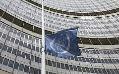 FILE: A flag is flown at half-staff in front of the International Atomic Energy Agency (IAEA) building in Vienna, Austria, July 22, 2019. The IAEA lowered the flag to mourn the death of the agency's Director-General Yukiya Amano at the age of 72. (AP Photo/Ronald Zak)