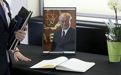 A book of condolence in front of a portrait of the late director general of the IAEA, Yukiya Amano, in Vienna, Austria, July 22, 2019. (AP Photo/Ronald Zak)