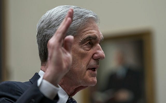 Former special counsel Robert Mueller is sworn in to testify to the House Judiciary Committee about his investigation into Russian interference in the 2016 election, on Capitol Hill in Washington, July 24, 2019. (AP Photo/J. Scott Applewhite)