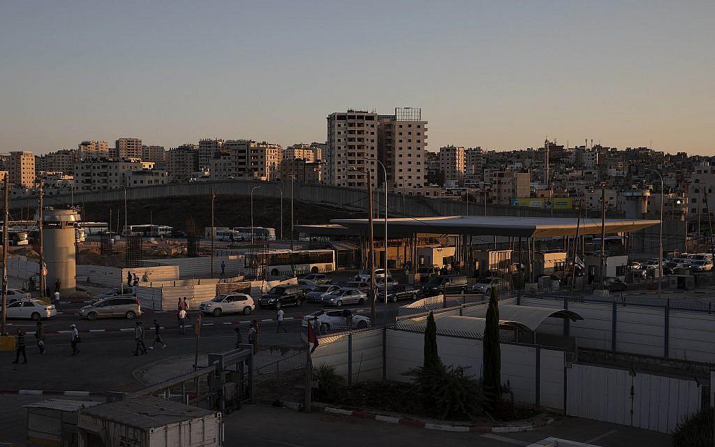 Cars pass the Qalandiya crossing between the West Bank city of Ramallah and Jerusalem, July 11, 2019. (Sebastian Scheiner/AP)
