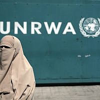 A Palestinian woman attends a demonstration outside the outside UNRWA's Headquarters in Gaza City, Sunday, Aug. 16, 2015. (AP Photo/Khalil Hamra)