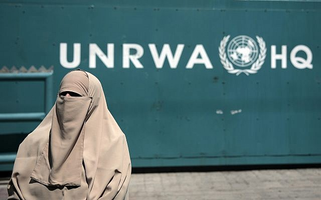 A Palestinian woman attends a demonstration outside the outside UNRWA's Headquarters in Gaza City, August 16, 2015. (AP Photo/Khalil Hamra)