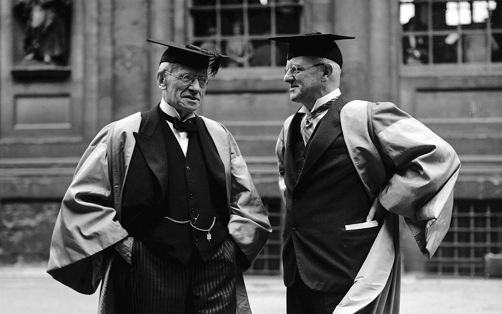 British author P.G. Wodehouse, right, talks to scholar Sir Herbert Grierson after receiving his honorary degree of Doctor of Laws at Oxford University, June 21, 1939. (AP Photo/Sidney Beadel)