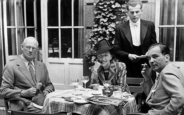 British author P.G. Wodehouse, left, is reunited with his wife Ethel after being released from internment in Berlin, August 13, 1941. The couple are chatting with a Foreign Office representative on the terrace of a German hotel, according to the Nazi censor-approved caption. (AP Photo)