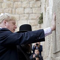 Then-mayor of London Boris Johnson touches the Western Wall in Jerusalem's Old City on Nov. 11, 2015. (AP Photo/Ariel Schalit)