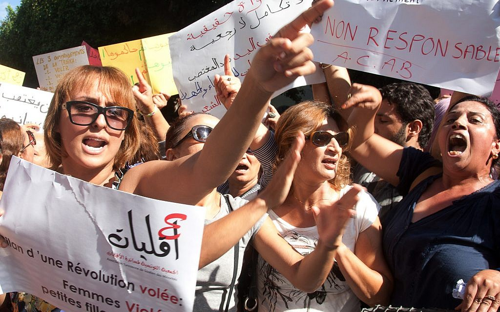 Hundreds of Tunisian women protest in support of a woman who says she was raped by police and is facing accusations of violating modesty laws in Tunis, Tuesday, October 2, 2012. (AP Photo/Amine Landoulsi)