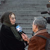 Hungarian philosopher Agnes Heller is interviewed by German Deutsche Welle TV company during an anti-goverment demonstration in front of the Hungarian Parliament building in Budapest, Hungary, Sunday, Feb. 1, 2015. (AP/MTI,Zoltan Mathe)