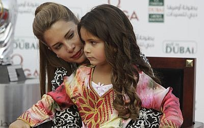 Princess Haya Bint Al Hussein holds her daughter Al Jalilah in her lap during the award ceremony of Dubai Ladies Masters golf tournament in Dubai, United Arab Emirates, Saturday Dec. 8, 2012. (AP Photo/Kamran Jebreili)