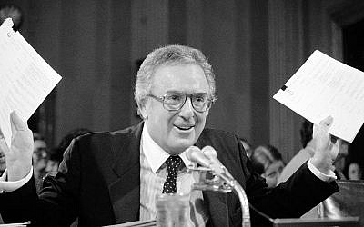 Former Florida Senator Richard Stone holds up lists of the names of Latin American officials during his nomination hearing to become Ambassador at Large for Central America before the Senate Foreign Relations Committee, May 20, 1983 on Capitol Hill. (AP Photo/Ira Schwarz)
