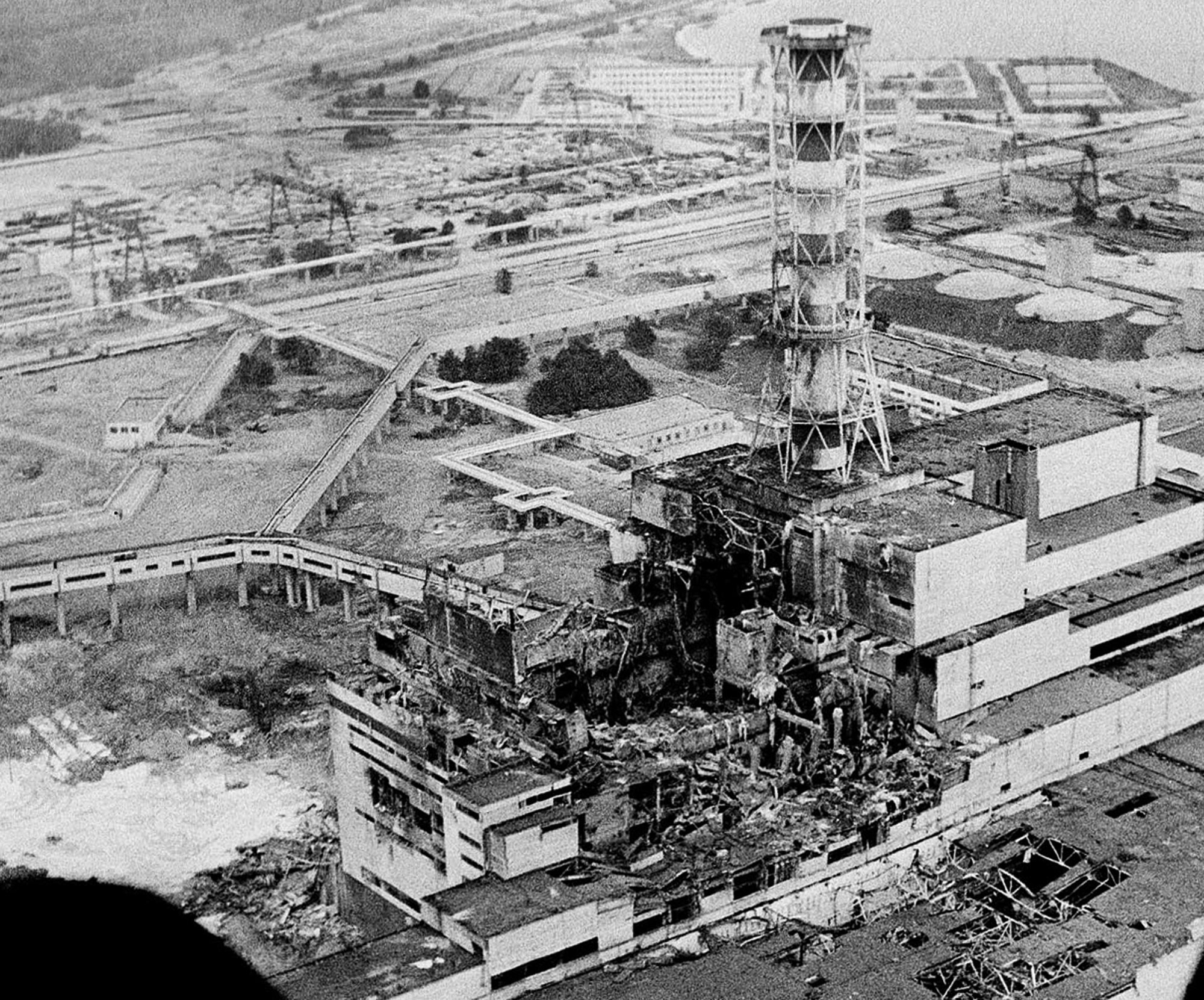 An aerial view of the Chernobyl nuclear power plant, the site of the world's worst nuclear accident, is seen two to three days after the April 26, 1986, explosion. In front of the chimney is the destroyed 4th reactor.   (AP Photo)