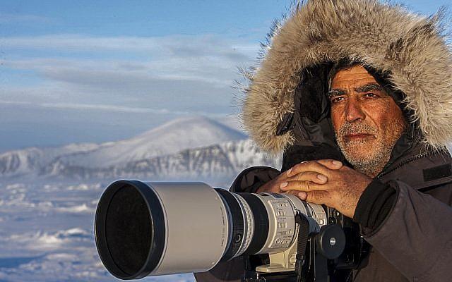 Wildlife photographer Amos Nachoum in the High Arctic. (Susan Friedman)
