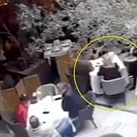 Screen capture from video of a woman in a blonde wig seen talking with two Israeli men who were gunned down moments later by suspected assassins in Mexico City, July 27, 2019. (YouTube)