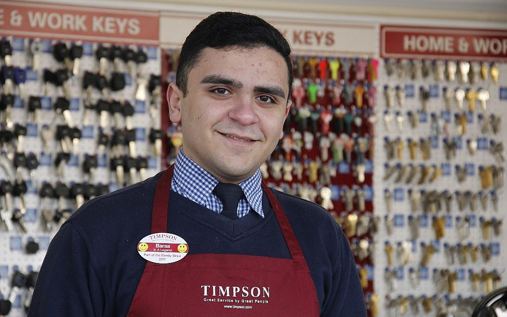 This graduate of World Jewish Relief's STEP program now works at UK retailer Timpson. (Courtesy)