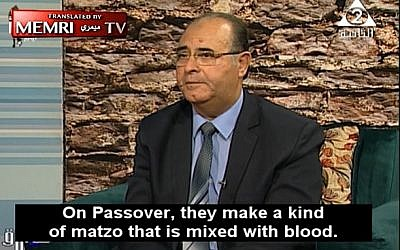 Screen capture from video of Fouad AbdelWahed, a professor at King Saud University, claiming Jews use blood in their matzah. (YouTube)