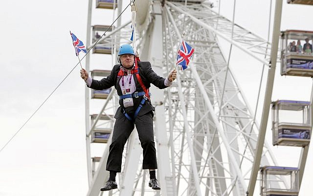 Boris Johnson waits to glide on a zip line onto the Olympic Park in London, Aug. 1, 2012. (Barcroft Media/Barcroft Media via Getty Images, JTA)