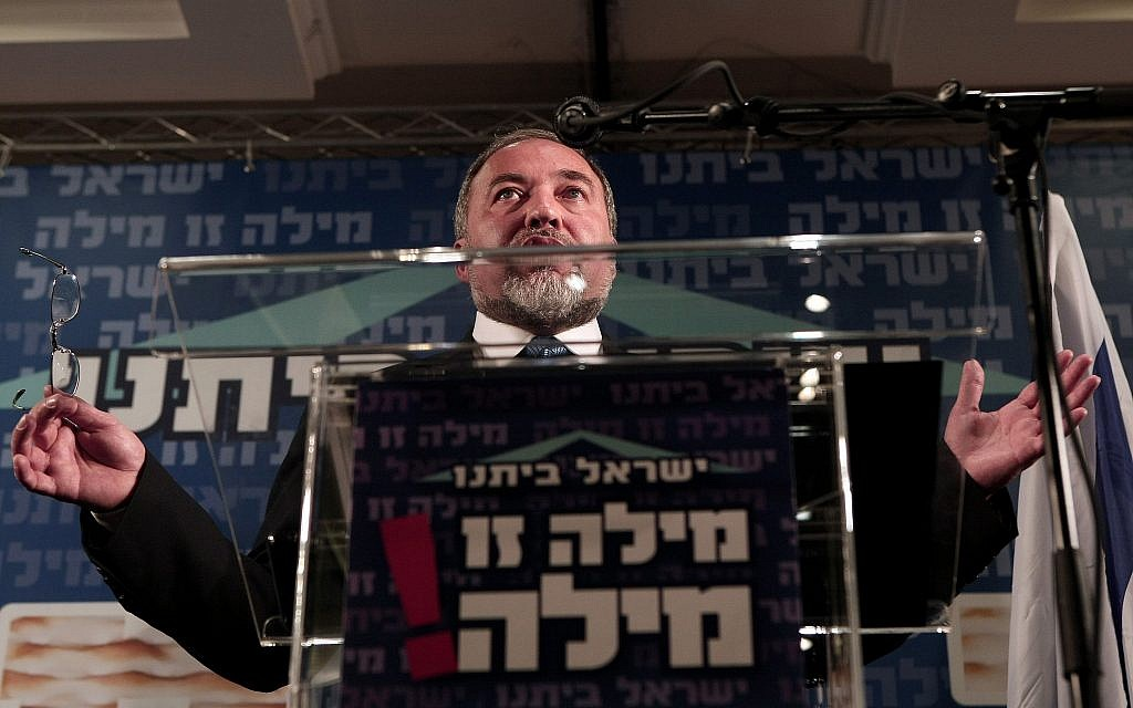 Israeli Foreign Minister and leader of Israel's nationalist Yisrael Beitenu party, Avigdor Lieberman, at a podium with party slogan, 'Our word is our word.' Tuesday, Apr 3, 2012. (Kobi Gideon / FLASH90)