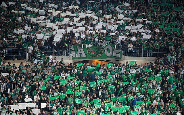 Illustrative: Fans of the Maccabi Haifa soccer team cheer during a game at the Teddy stadium in Jerusalem, May 24, 2016. (Yonatan Sindel/Flash90)