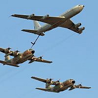 A Boeing 707 refueling plane and C-130 Hercules transport aircraft demonstrate aerial refueling at a graduation ceremony for soldiers who completed the Israeli Air Force's flight course, at the Hatzerim Air Base in the Negev Desert, June 28, 2016. (Ofer Zidon/Flash90)