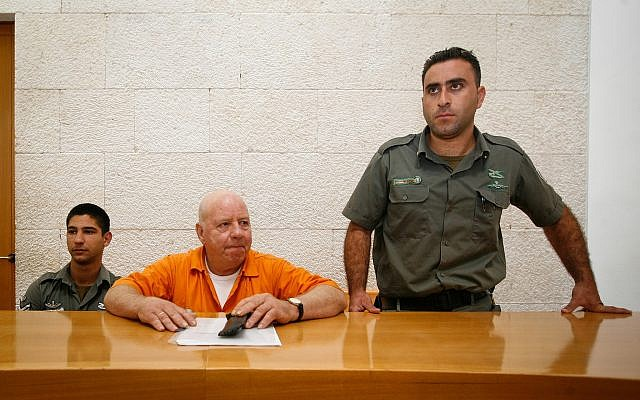 Illustrative: Tzvi Gur, center, serving a life-sentence for the death of a young boy he kidnapped 28 years earlier, during a Supreme Court hearing in which he sought a few days furlough from prison, July 6, 2009. (Miriam Alster/Flash90