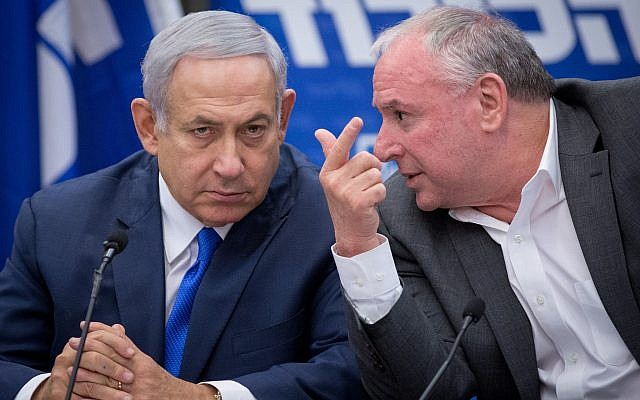 Prime Minister Benjamin Netanyahu (L) talks with then-coalition chairman MK David Amsalem during a Likud party faction meeting at the Knesset on November 19, 2018. (Miriam Alster/Flash90)