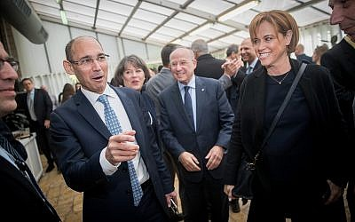 Bank of Israel Professor Amir Yaron, left, seen with CEO of Leumi Bank, Rakefet Rosek-Aminach, right, at his appointment ceremony held at the President's Residence in Jerusalem, December 24, 2018 (Yonatan Sindel/Flash90)