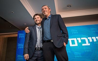 Rafi Peretz (R) and Bezalel Smotrich of the Union of Right-Wing Parties, at a campaign event in Jerusalem on March 11, 2019. (Yonatan Sindel/Flash90)