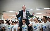 Rafi Peretz, leader of the Jewish Home party, dances with activists of the Union of Right-Wing Parties in Jerusalem, April 8, 2019 (Yonatan Sindel/Flash90)