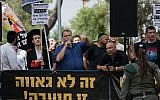 Otzma Yehudit member Benzi Gopstein (with microphone), head of the anti-miscegenation group Lehava, leads a demonstration against the Jerusalem Gay Pride parade on June 6, 2019. (Yonatan Sindel/Flash90)