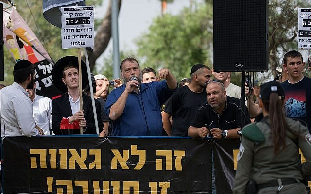 Otzma Yehudit member Benzi Gopstein (with microphone), head of the anti-miscegenation group Lehava, leads a demonstration against the Jerusalem Gay Pride parade on June 6, 2019. (Yonatan Sindel/Flash90)