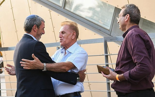 URWP chairman Rafi Peretz (L) arrives at a gathering of the Jewish Home party in Ramat Gan on June 19, 2019. (Yehuda Haim/Flash90)