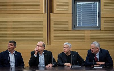 From right to left: Blue and White leaders Benny Gantz, Yair Lapid, Moshe Ya'alon, and Gabi Ashkenazi at a faction meeting at the Knesset on June 24, 2019. (Yonatan Sindel/Flash90)