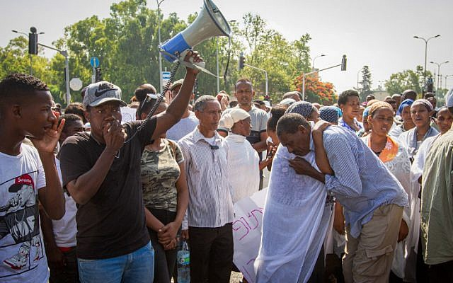 Ethiopian-Israelis, family members and activists protest following the death of 19-year-old Solomon Tekah, who was shot and killed the previous night by an off-duty police officer in Kiryat Haim, July 1, 2019. (Meir Vaknin/Flash90)