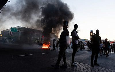 Ethiopian Israelis protest following the shooting death of 19-year-old Ethiopian, Solomon Tekah, in Kiryat Haim by an off-duty police officer, outside Kiryat Ata, July 1, 2019. (Meir Vaknin/Flash90)