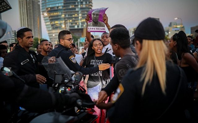 Ethiopian Israelis and supporters protest following the death of 19-year-old Ethiopian, Solomon Tekah who was shot and killed June 30 in Haifa by an off-duty police officer, in Tel Aviv, July 2, 2019. (Hadas Parush/Flash90)